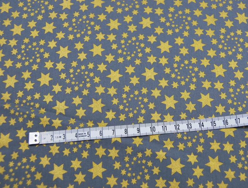 Baumwolle Grau mit goldenen Sternen 0 5m