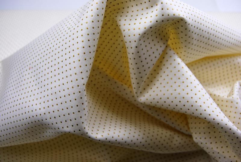 Creme Baumwolle mit Minipunkten in Gold