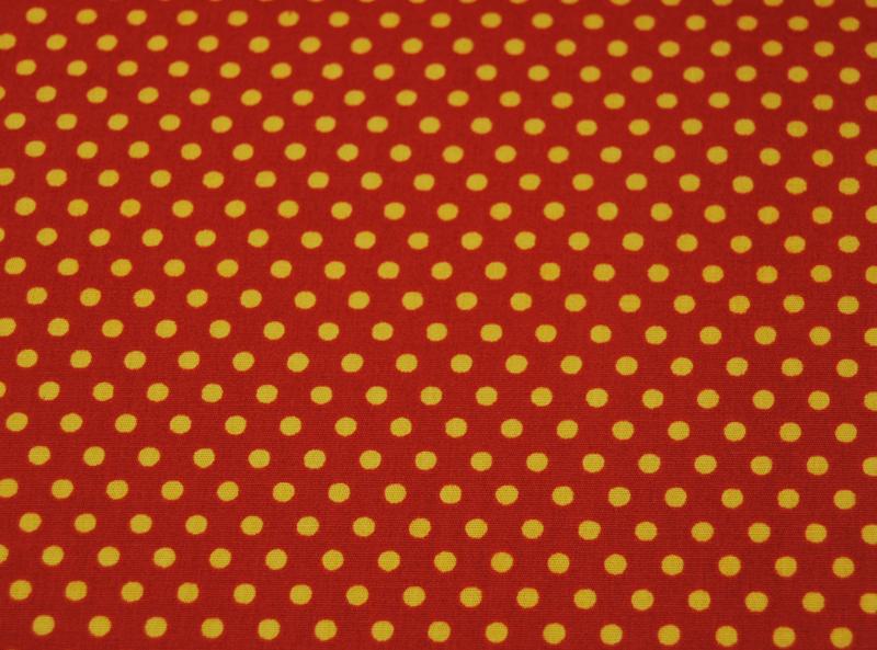Gelbe Punkte auf terracottafarb. Baumwolle 0,5m - 2