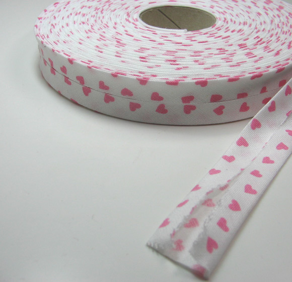 Schrägband: Meter Weiß mit rosa Herzen
