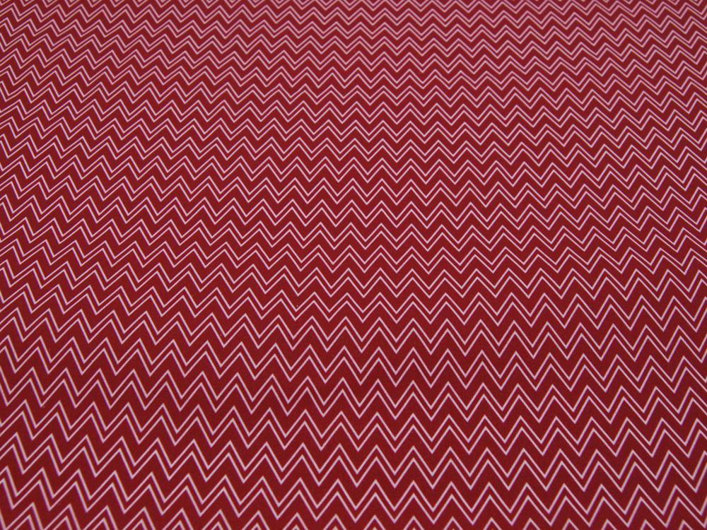 Beschichtete Baumwolle - Zackenmuster Dunkelrot -