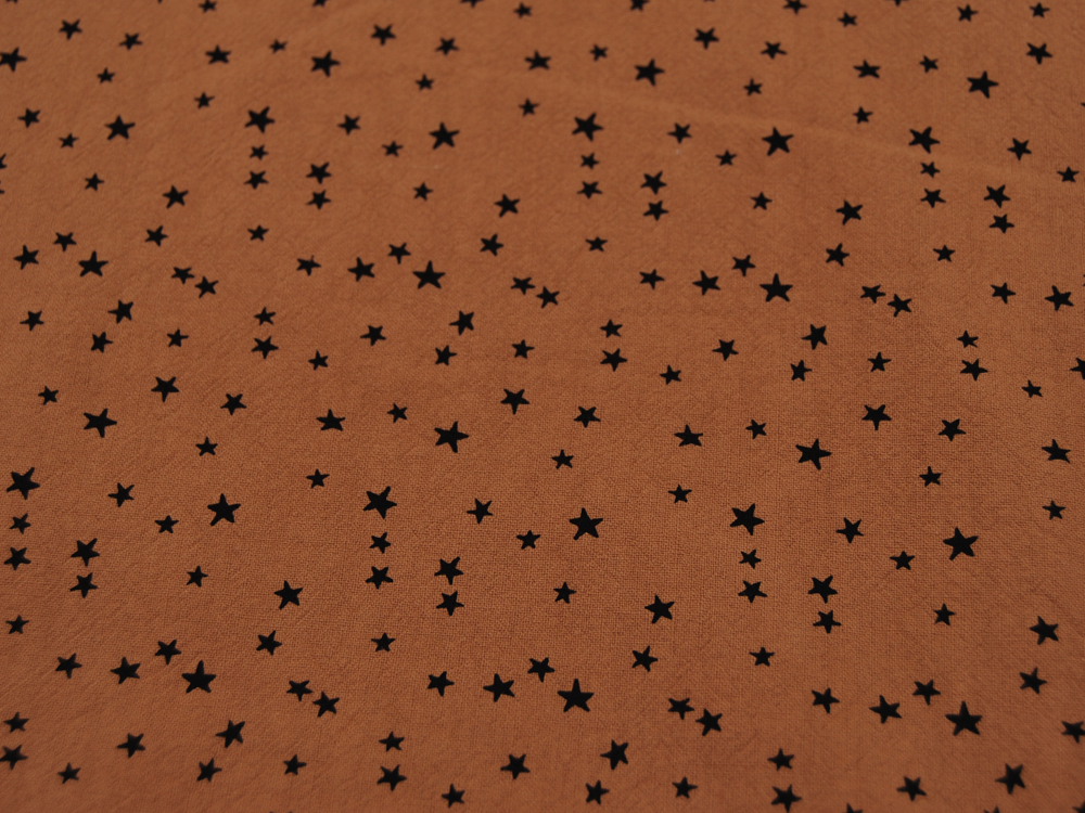 Baumwolle - Schwarze Sterne auf Cognac