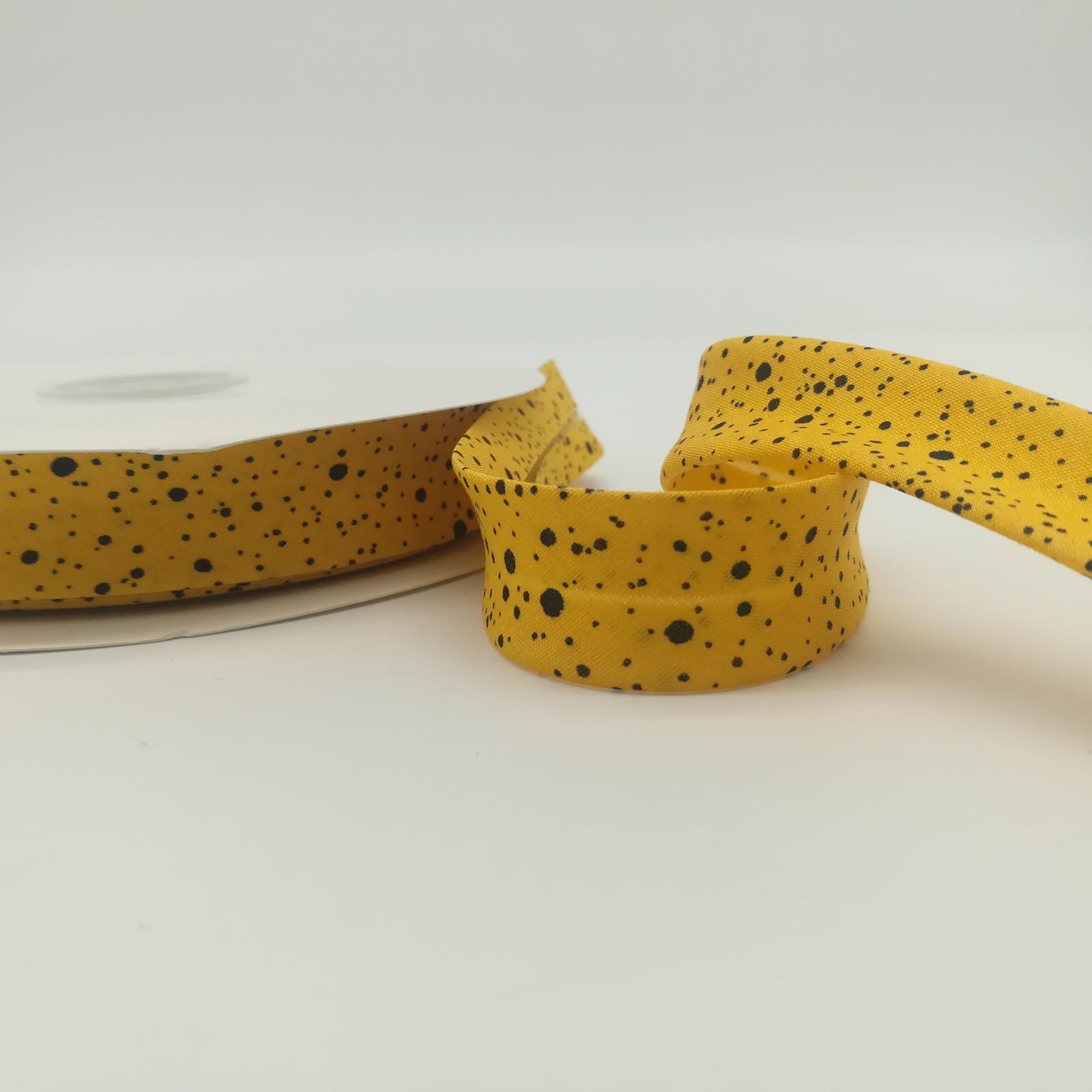 Schrägband Meter Senfgelb mit kleinen schwarzen
