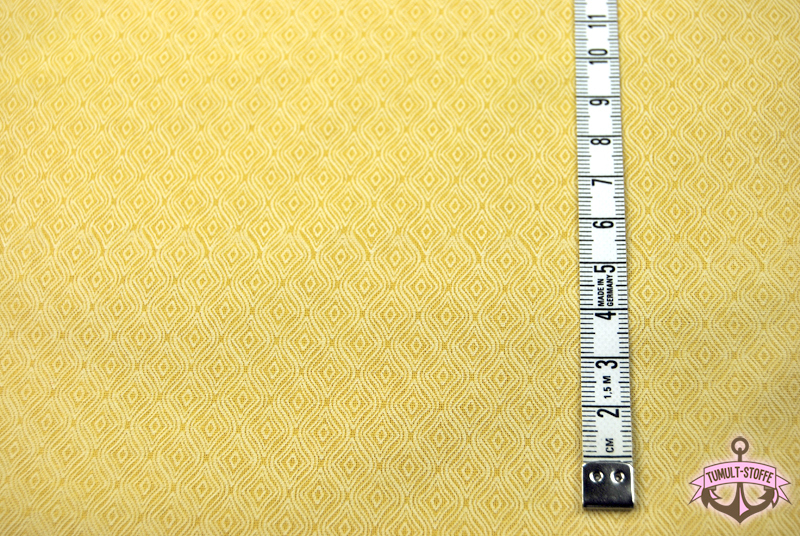 Sonnengelbe Baumwolle mit weißen Muster 0,5 m - 1