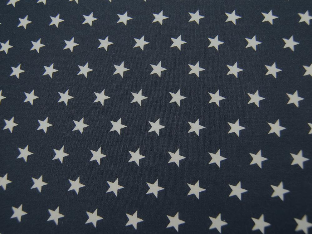 Beschichtete Baumwolle Weiße Sterne auf Dunkelblau