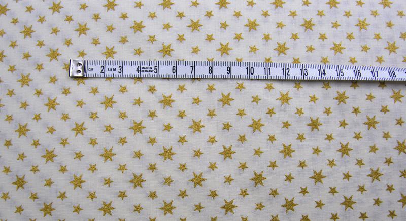 Helle Baumwolle mit goldenen Sternen 0 5m