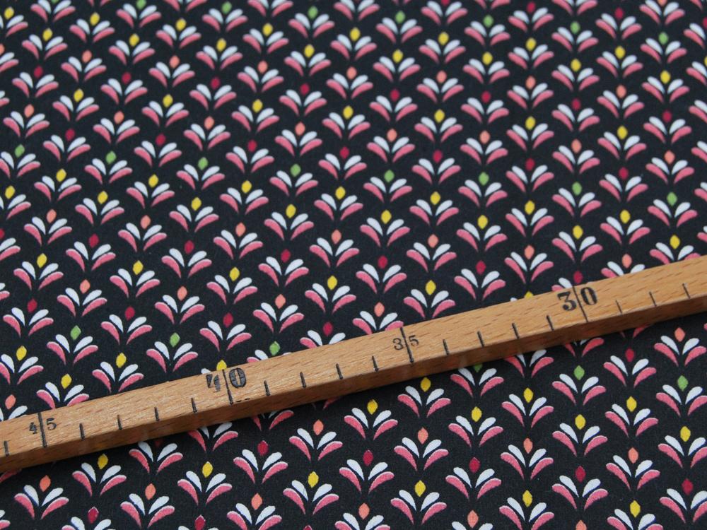 Beschichtete Baumwolle Blütenmuster auf Schwarz 50x145cm