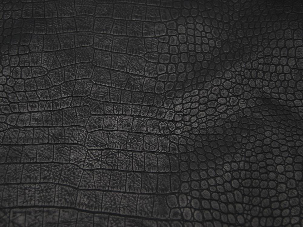 Kunstleder mit Muster auf Schwarz cm