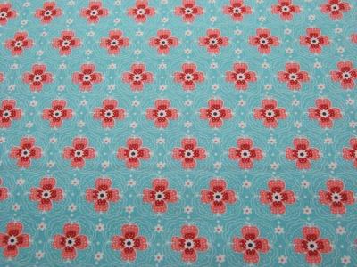 Beschichtete Baumwolle - Blumenmuster auf Hellblau 50x68 cm