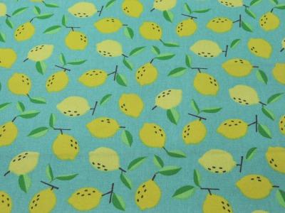 Beschichtete Baumwolle Zitronen auf Hellblau x75