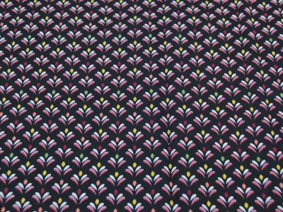 Beschichtete Baumwolle Blütenmuster auf Schwarz 50x74
