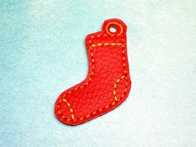 Schlüsselanhänger rote Socke mit gelben Akzenten