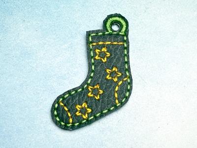 Schlüsselanhänger dunkelgrüne Socke mit gelben Sternen