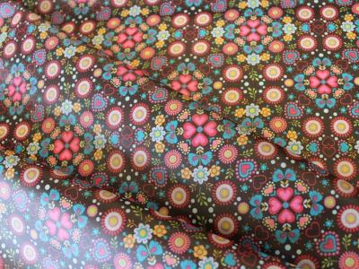 Beschichtete Baumwolle Blumen Ornamente braun