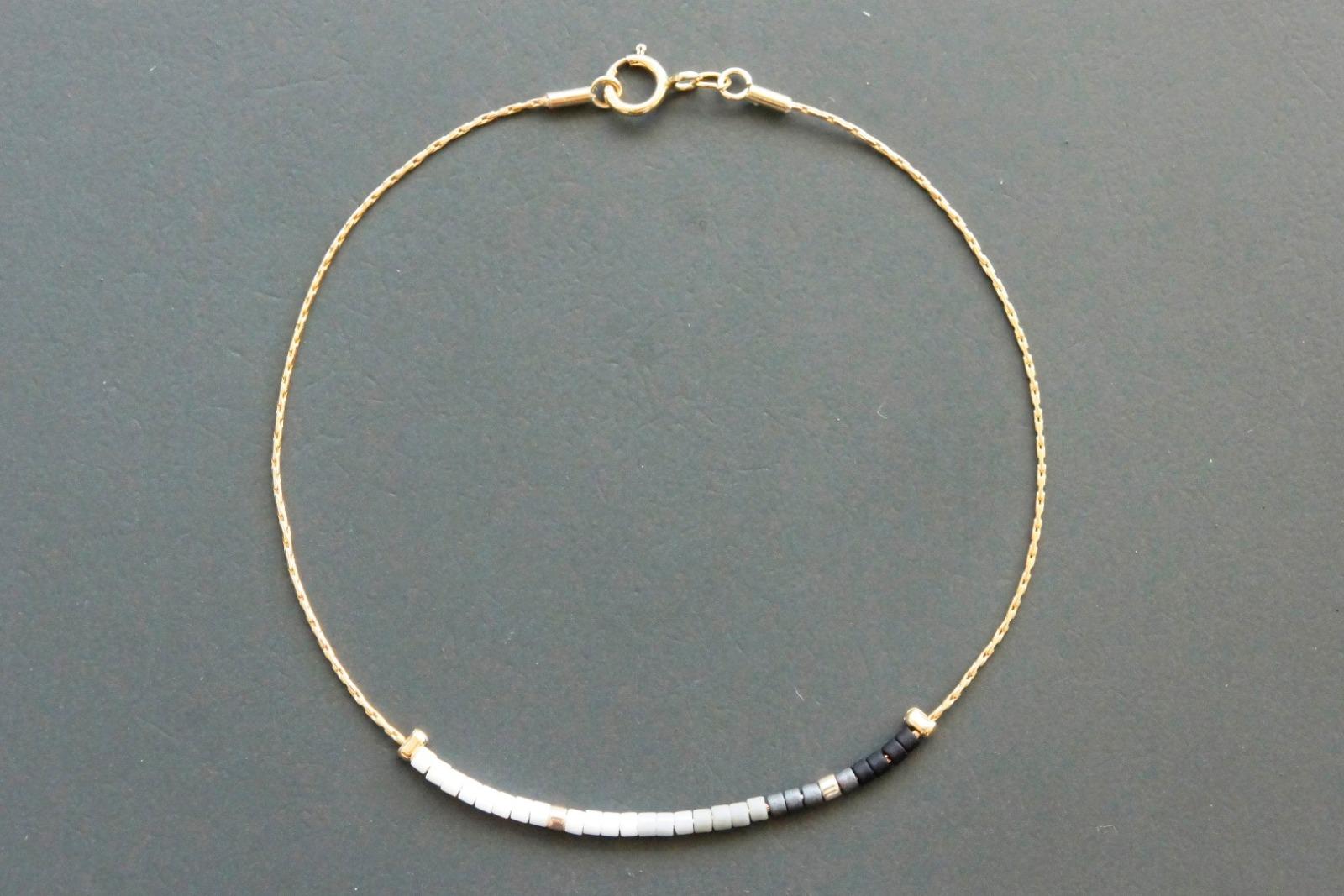 Filigranes Armband gold mit Verlauf schwarz-weiß