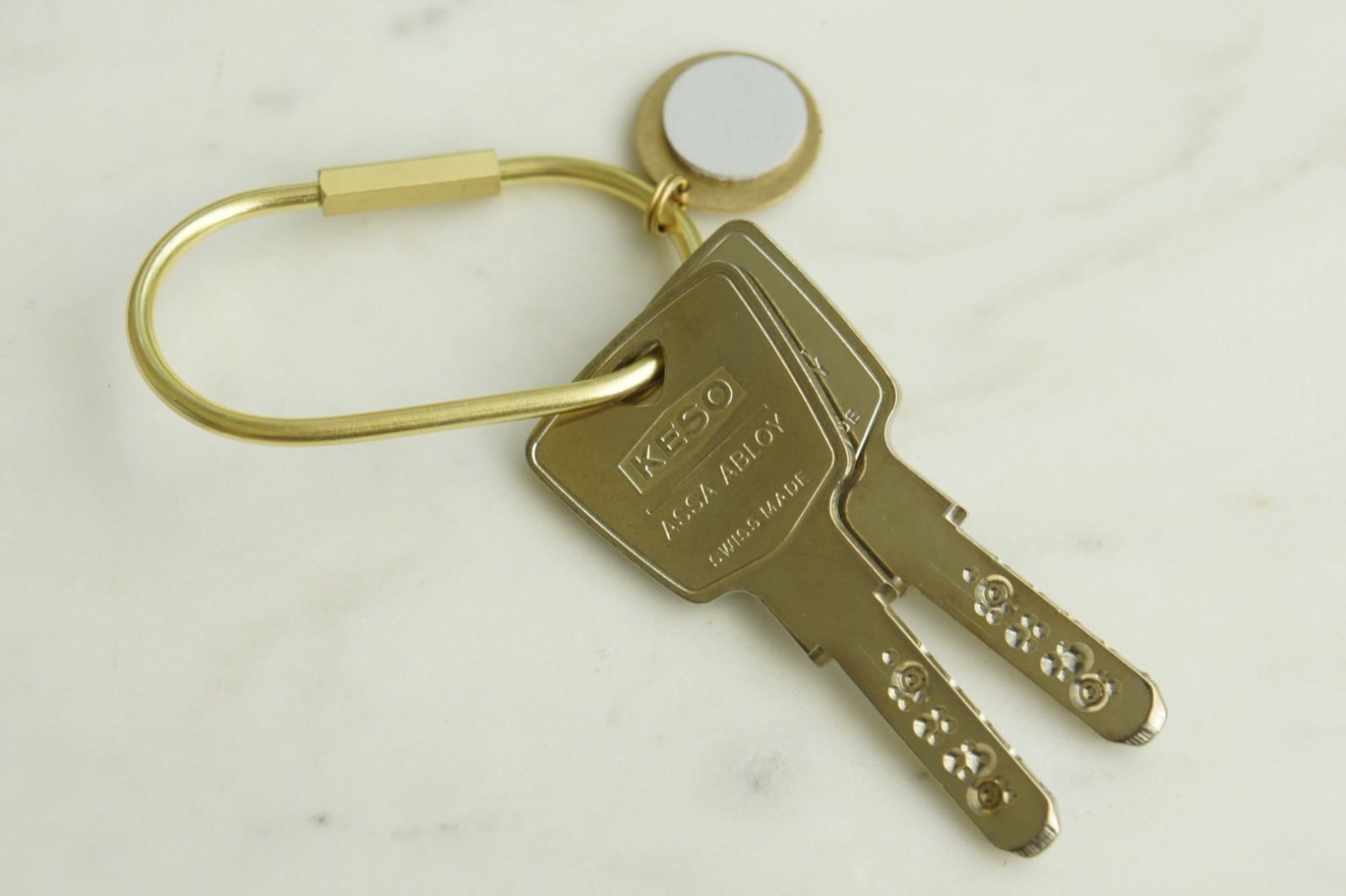 Schlüsselring Oval mit Anhänger hellgrau 3