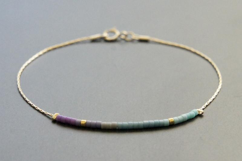 Filigranes Armband gold mit Verlauf lila-türkis