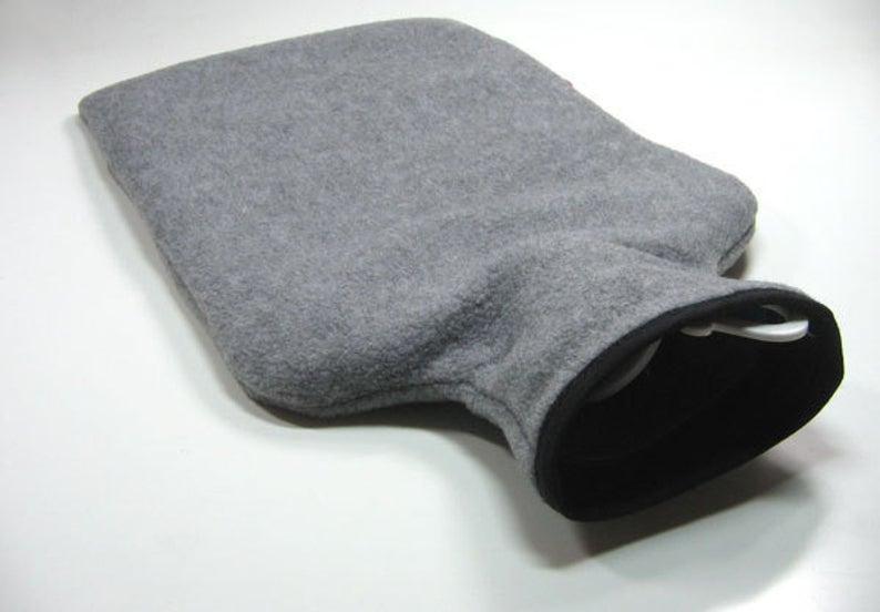 Wärmflasche - Graumeliert mit schwarzem Schaf