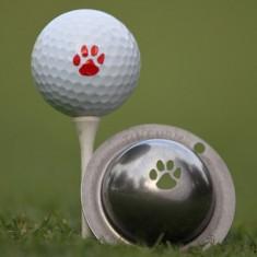 Tin Cup - Trail Blazer - Der Tin Cup ist eine Ball Schablone aus Edelstahl mit dem Design einer Tier Pfote. Mit einem feinen und wasserfesten Stift laesst sich dann das Design auf den Golf Ball malen.