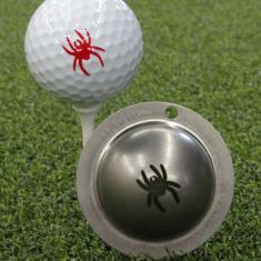 Tin Cup - Spider - Der Tin Cup ist eine Ball Schablone aus Edelstahl mit dem Design einer Spinne. Mit einem feinen und wasserfesten Stift laesst sich dann das Design auf den Golf Ball malen.