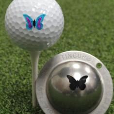 Tin Cup - Butterfly - Der Tin Cup ist eine Ball Schablone aus Edelstahl mit dem Design eines Schmetterlings. Mit einem feinen und wasserfesten Stift laesst sich dann das Design auf den Golf Ball malen.