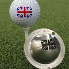 Tin Cup - Union Jack - Der Tin Cup ist eine Ball Schablone aus Edelstahl mit dem Design der englischen Fahne. Mit einem feinen und wasserfesten Stift laesst sich dann das Design auf den Golf Ball malen.