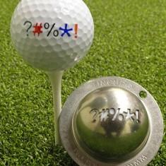Tin Cup - Out of Bounds - Dieser Tin Cup ist eine Ball Schablone aus Edelstahl mit den Symbolen eines Schimpfwortes . Mit einem feinen und wasserfesten Stift laesst sich dann das Design auf den Golf Ball malen.