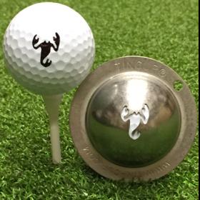 NEU Tin Cup - Scorpion - Dieser Tin Cup ist eine Ball Schablone aus Edelstahl mit dem Design eines Scorpions. Mit einem feinen und wasserfesten Stift laesst sich dann das Design auf den Golf Ball malen.