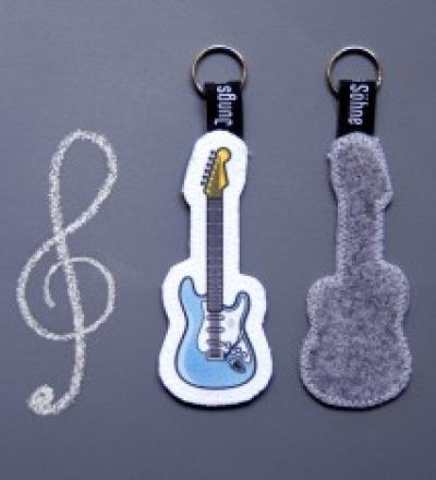 Anhaenger Gitarre tuerkis