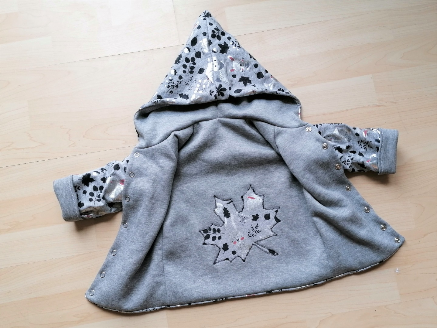 Wendejacke mit Zipfelkapuze für Babys und