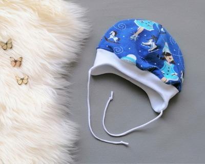 Bindemütze Baby Kind Eiskunstläuferin blau weiß