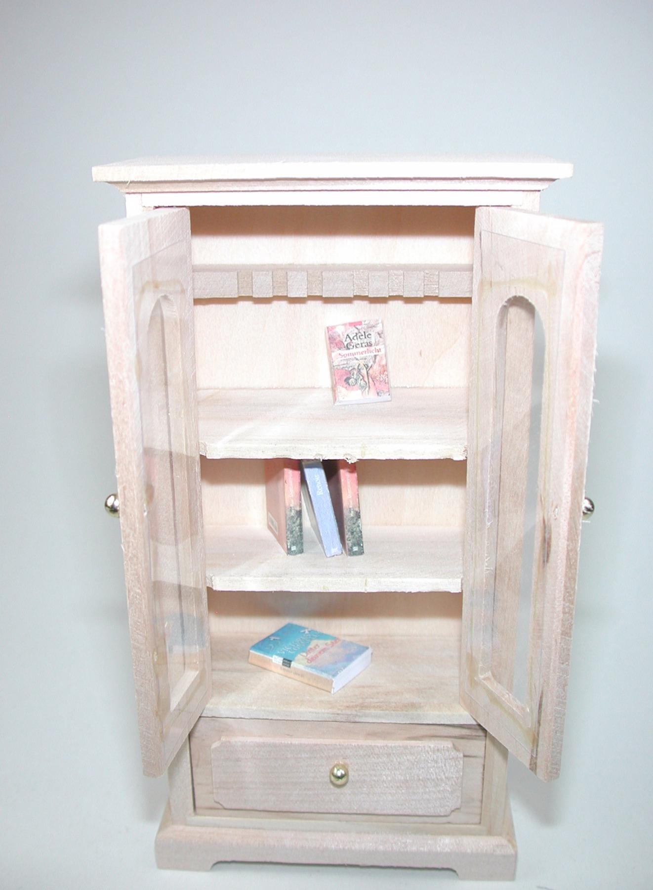 Bücherschrank mit mit einer Schublade für