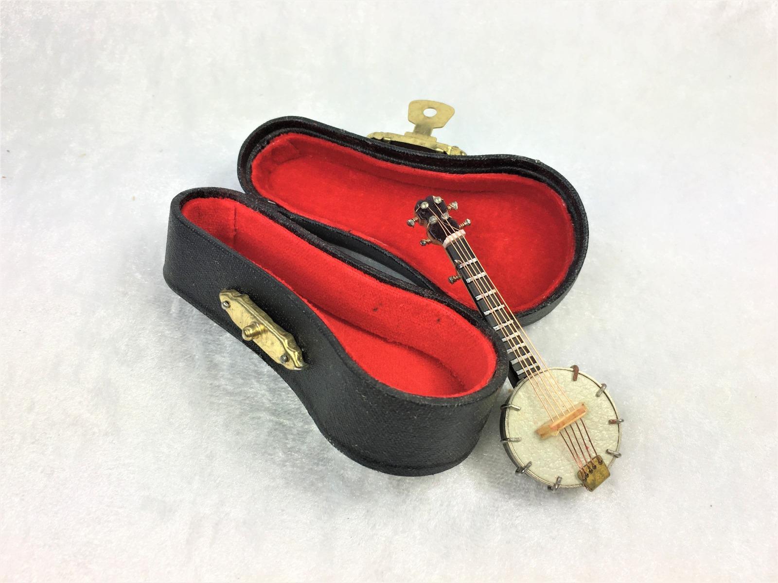 Musikinstrumente mit Koffer für die Puppenstube