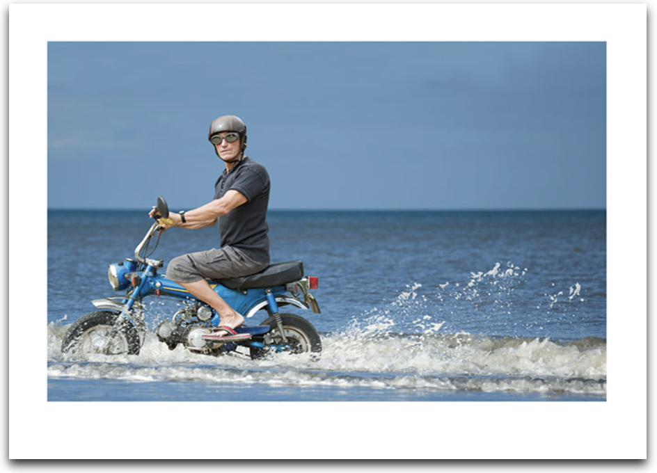 Man On Scooter In Water Card